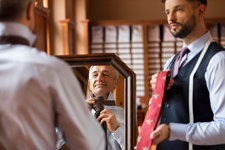 Tailor showing ties to businessman