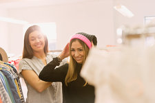 Fashion buyers trying on stocking cap