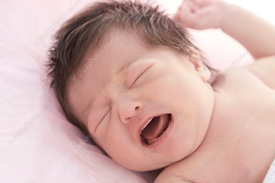 Newborn baby girl with eyes closed