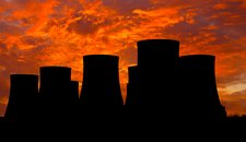 Power station cooling towers at sunset