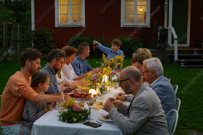 Family enjoying candlelight dinner party