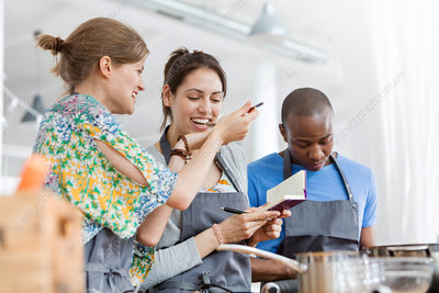 Women tasting food in cooking class