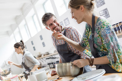 Couple enjoying cooking class kitchen