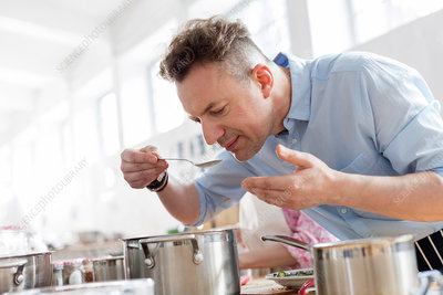 Man smelling food in cooking class