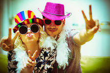 Couple in costume gesturing peace sign