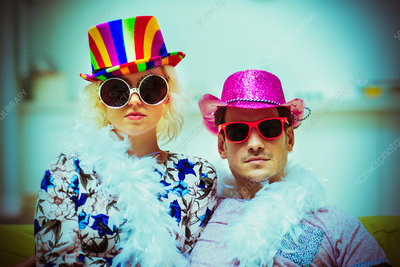 Couple wearing costume hats and sunglasses