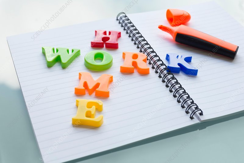 Colourful letters on notebook spelling homework
