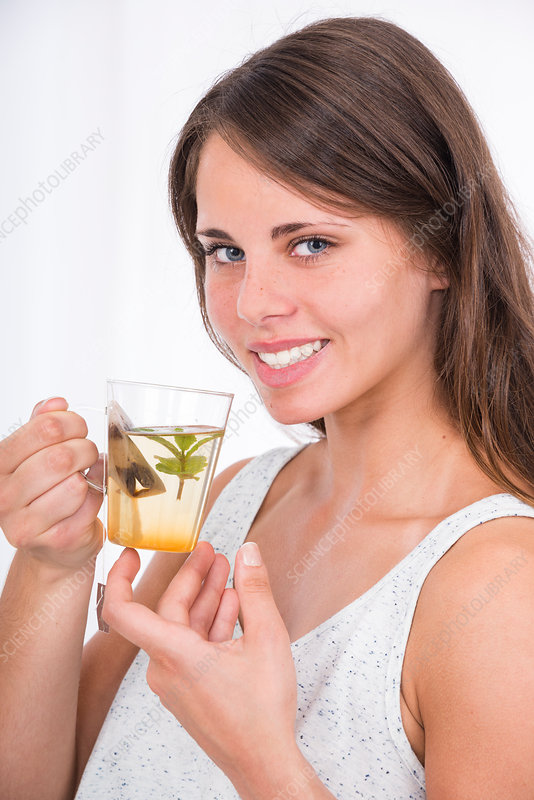 Young woman drinking herbal tea