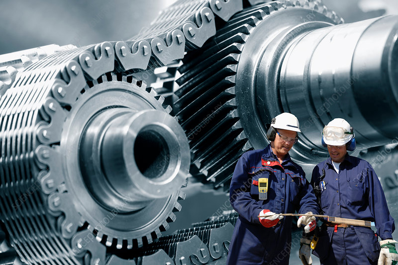 Industrial workers with metal cogs
