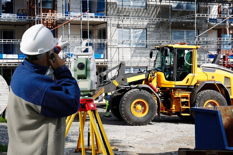 Construction site with man using theodolite