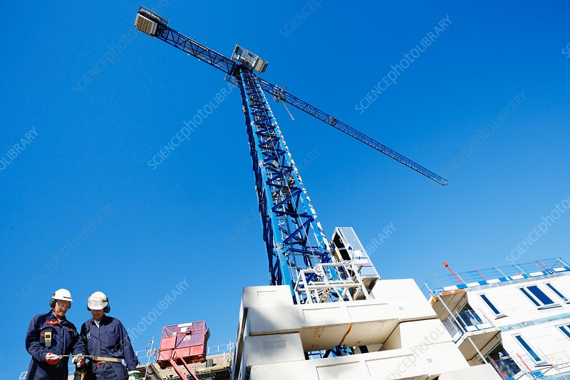 Construction workers on site crane
