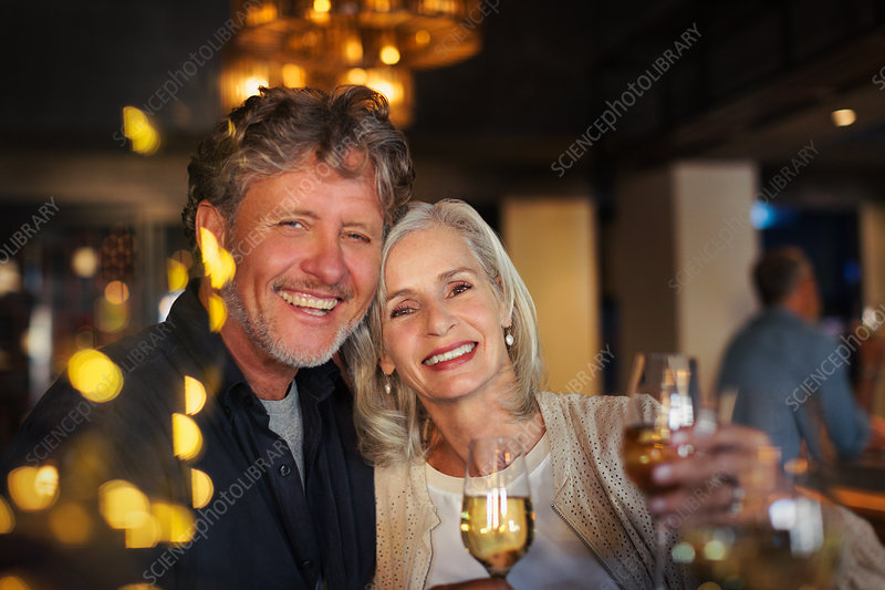 Portrait smiling senior couple toasting