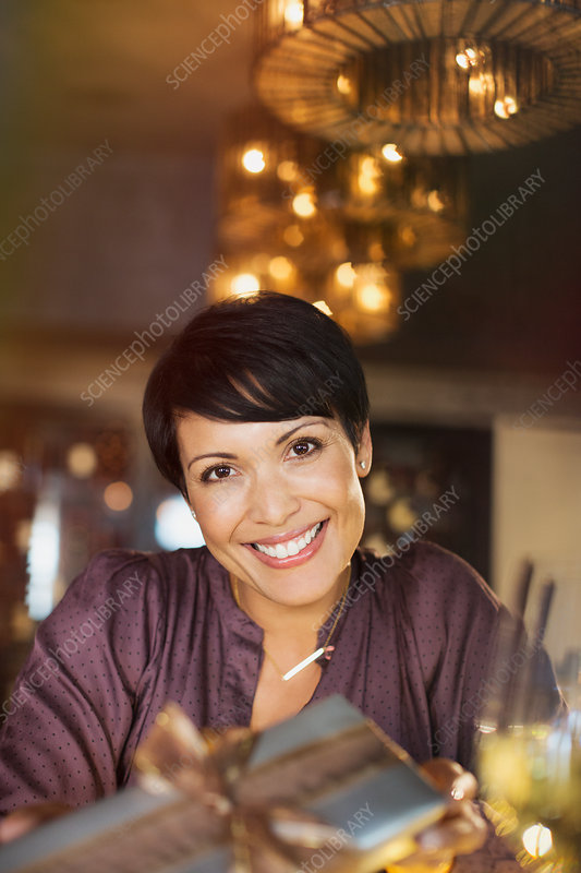 Portrait smiling woman giving gift
