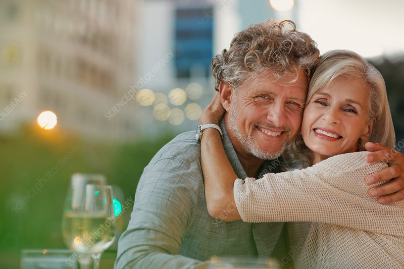 Portrait smiling senior couple hugging