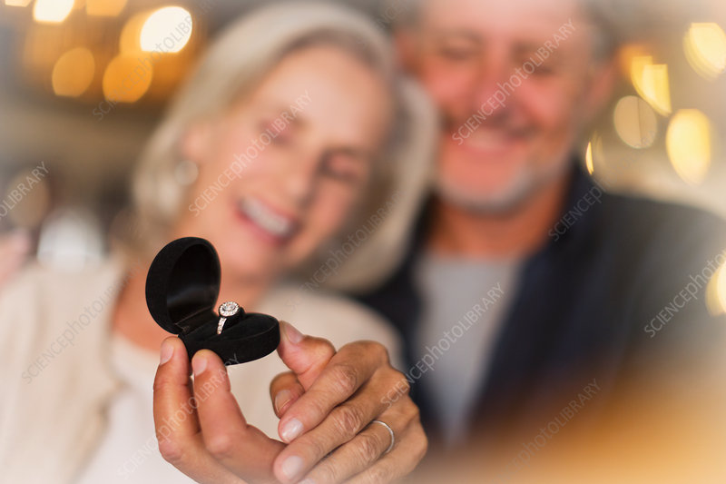 Senior woman receiving ring gift from husband