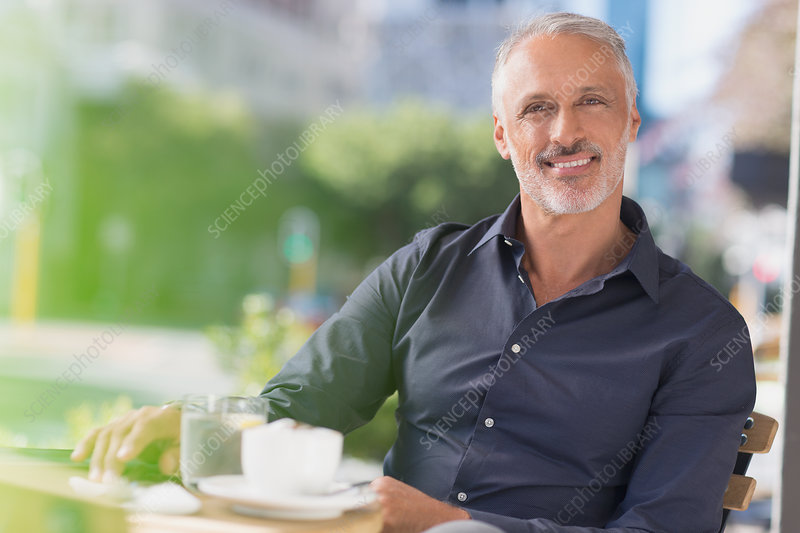 Portrait smiling man drinking coffee