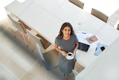 Portrait businesswoman drinking coffee