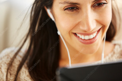 Close up smiling woman using digital tablet