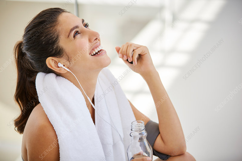 Laughing woman resting post workout