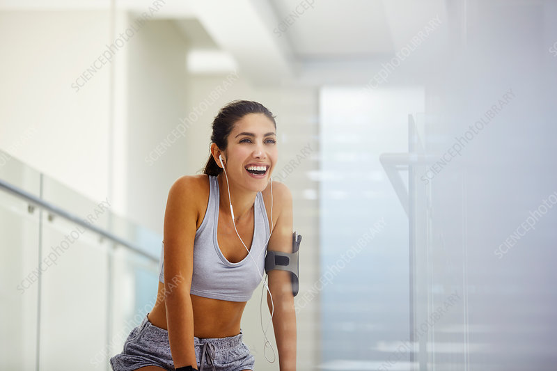 Woman listening to music post workout