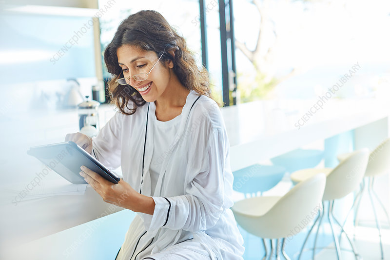 Businesswoman working using digital tablet