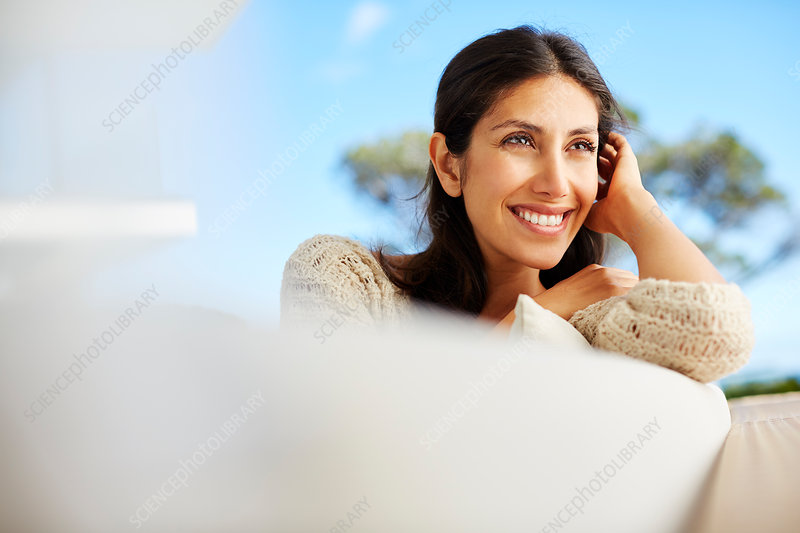 Smiling brunette woman looking away