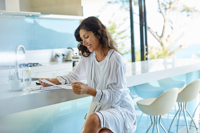 Businesswoman working reviewing paperwork