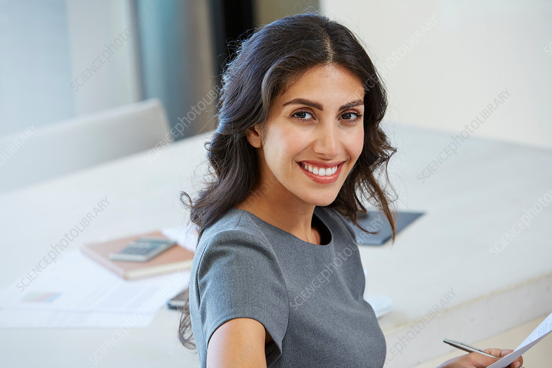Portrait businesswoman working in conference room