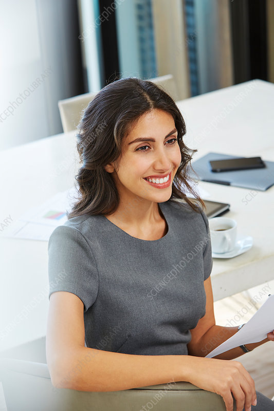 Smiling businesswoman working in conference room