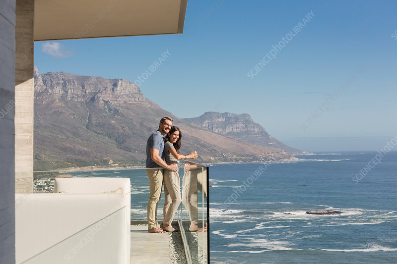 Couple looking at sunny ocean view