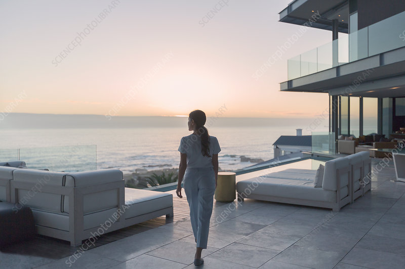 Woman walking on patio at sunset
