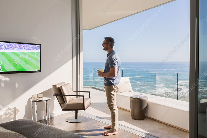 Man watching soccer on TV