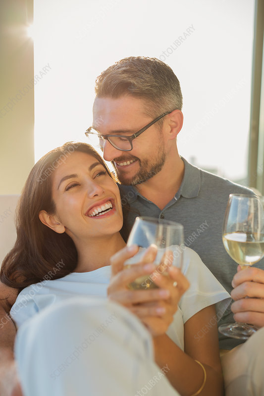 Affectionate couple drinking white wine