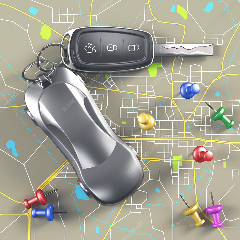 Car key and push pins in road map