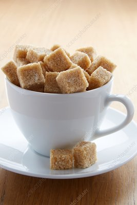 Tea cup full of sugar lumps