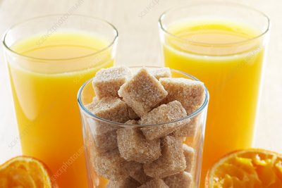 Freshly squeezed orange juice and sugar cubes