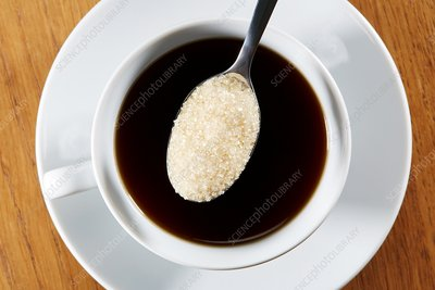 Cup of black coffee with spoonful of sugar