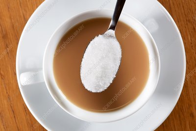 Cup of tea with spoonful of sugar