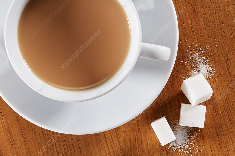 Cup of tea with sugar lumps