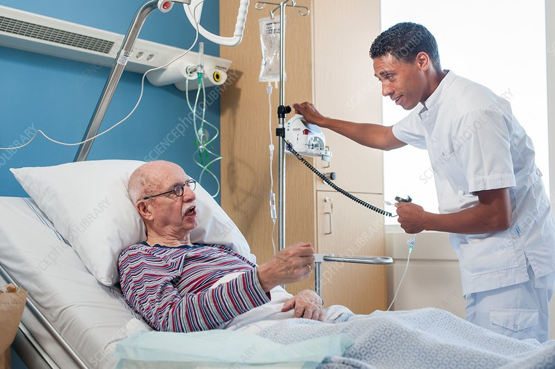 Male nurse treating senior man