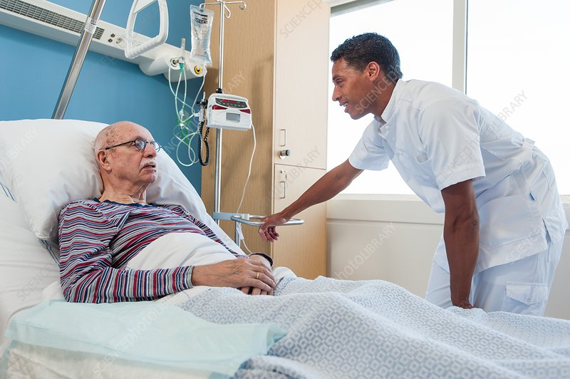 Male nurse talking to senior man