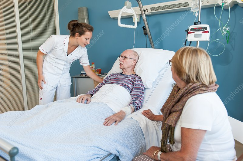 Nurse talking to senior man