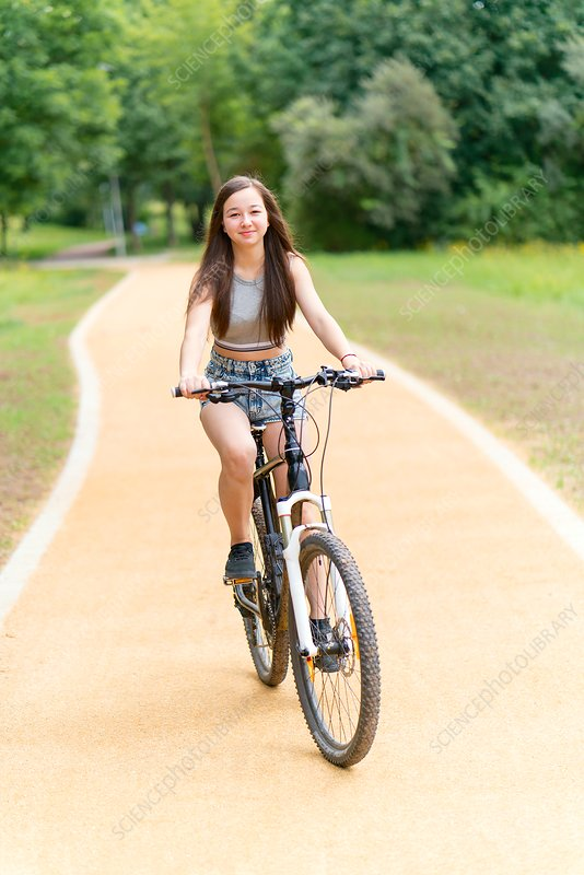 Girl riding bicycle on path