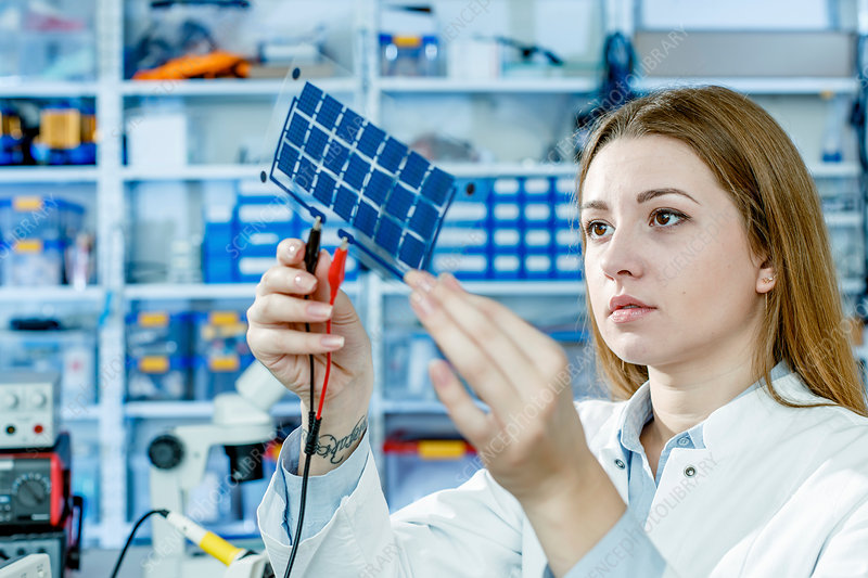Girl holding film solar cells