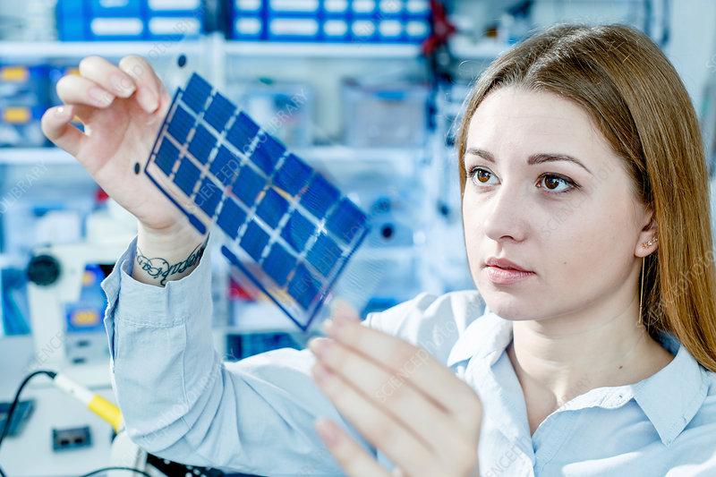 Girl holding film solar cells