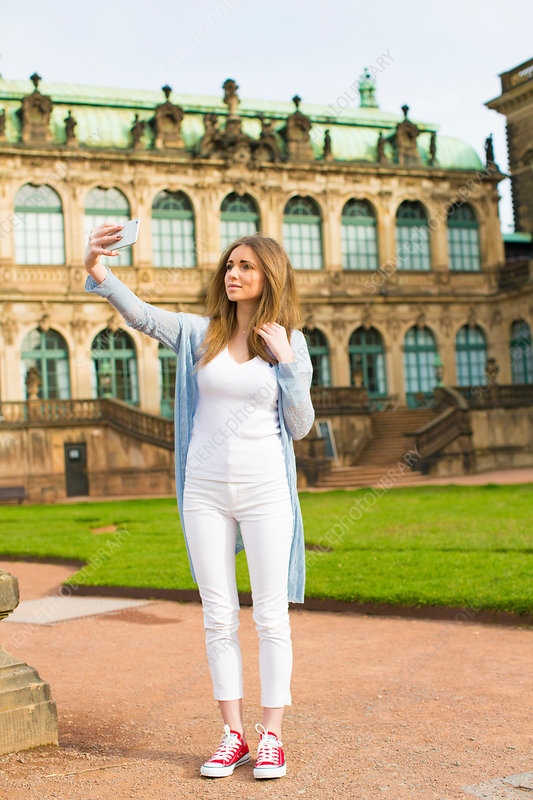 Young woman taking photo of herself