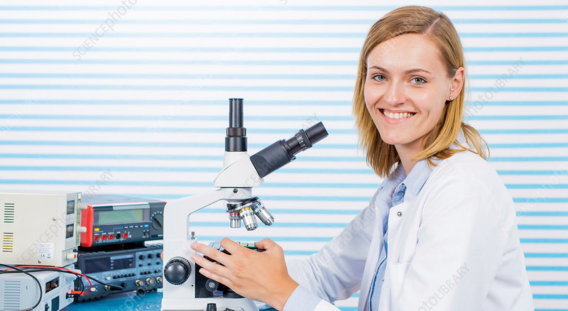 Portrait of woman with microscope