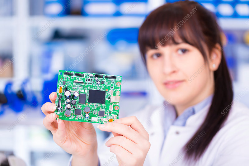 Woman holding circuit board, portrait