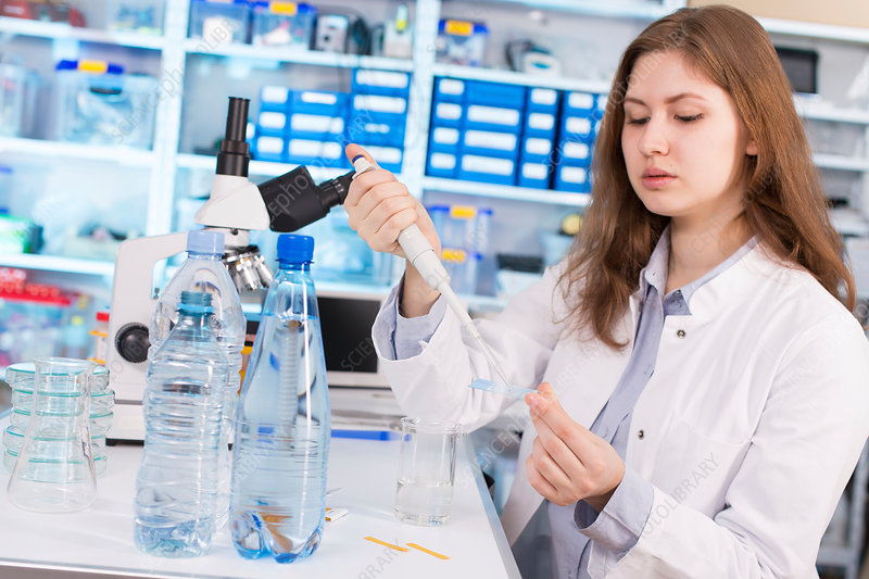 Woman using pipette