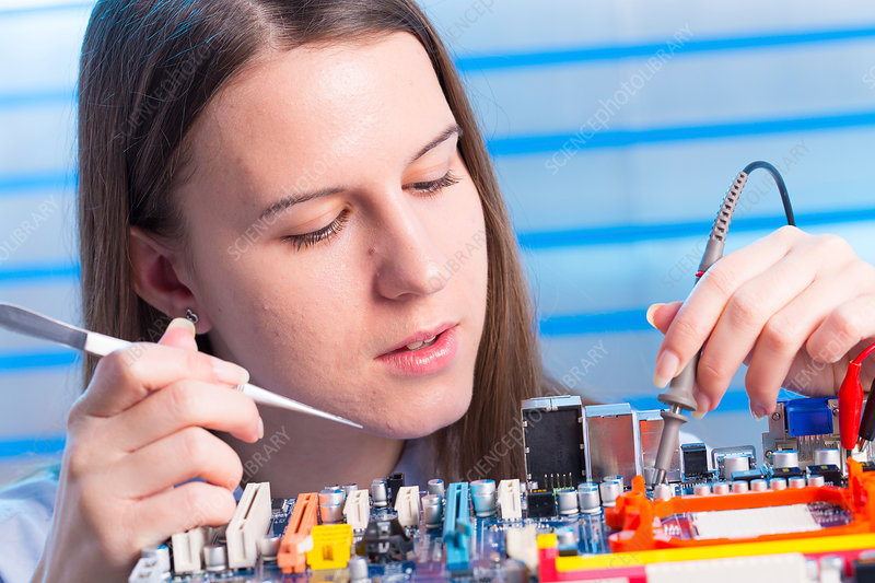 Young woman working on circuit board